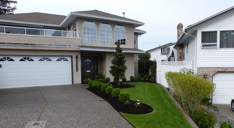 White Rock home after yard makeover by Fabulous Flower Beds