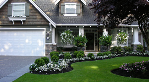 Landscaping portfolio fabulous flower beds for Flower bed in front of house